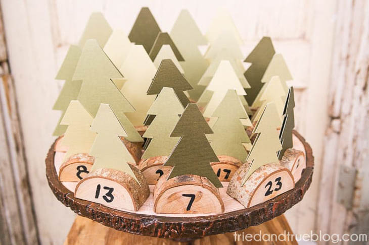 Advent calendar made with paper trees and wood slice bases