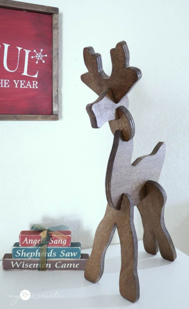 Wooden reindeer sitting on table top