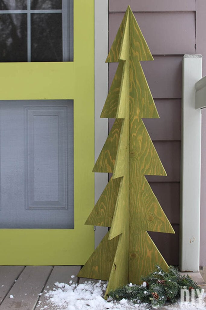 Light green plywood 3D Christmas tree on front porch