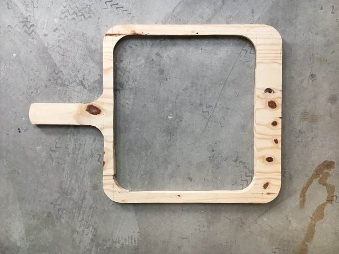 Cut out of the cutting board shape. The center has been cut out too.