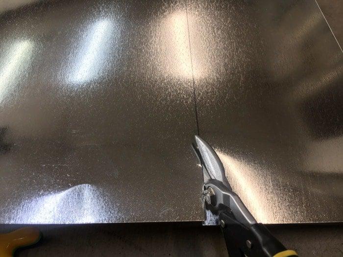Cutting sheet metal with tin snips