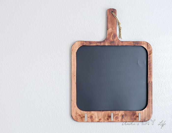 Final finished blank cutting board shaped magnetic chalkboard on the wall