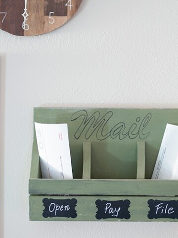 This easy DIY wall mail organizer is the perfect beginner woodworking project. Make it with simple hand tools. No power tools needed. Step by step instructions and printable plans along with video tutorial.