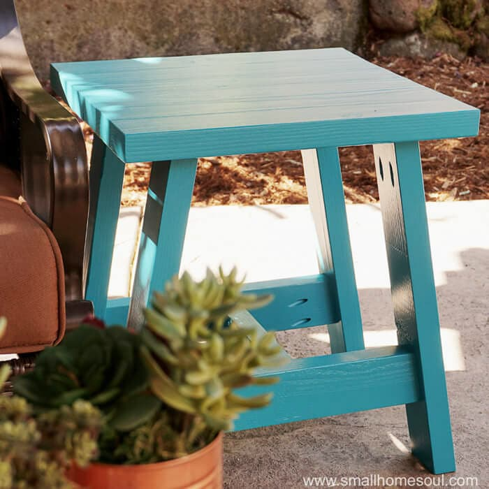 Simple blue outdoor side table made from 2x4 wood