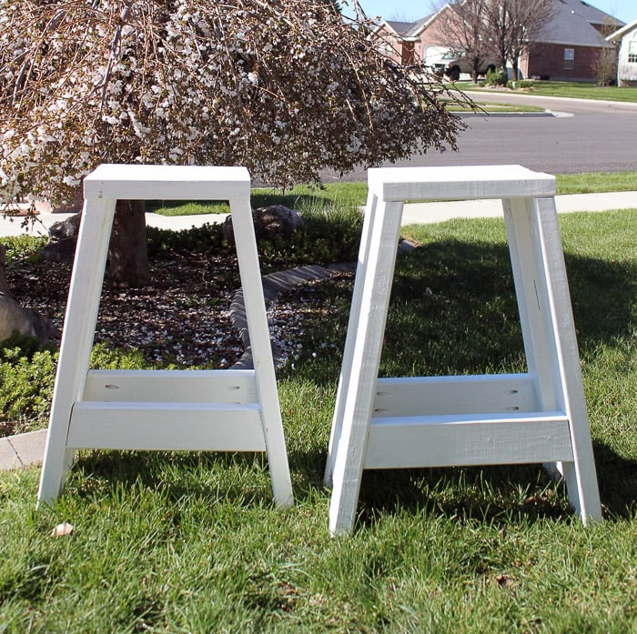 white DIY barstools made from 2x4 wood on grass