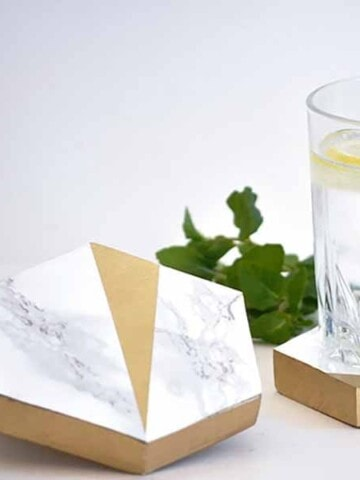 DIY hexagonal marble and gold coasters with glass of water