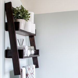 A DIY floating ladder shelf that fits in perfectly with any decor or room. Combine DIY floating shelves and DIY ladder shelves to create this unique open shelf. The step by step plans show you how to build this perfect alternative to simple open shelves.