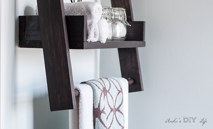 Floating ladder shelf with towel bar.