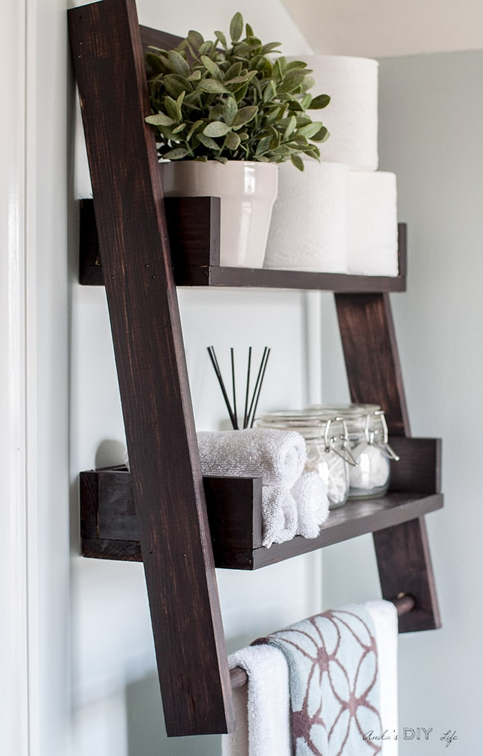Full view of the DIY floating ladder shelf mounted on the wall.
