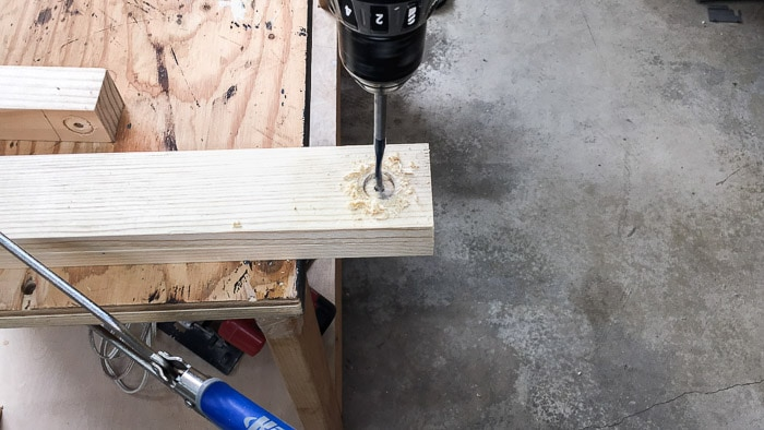 "Drilling hole in 1""x3"" board using spade bit"