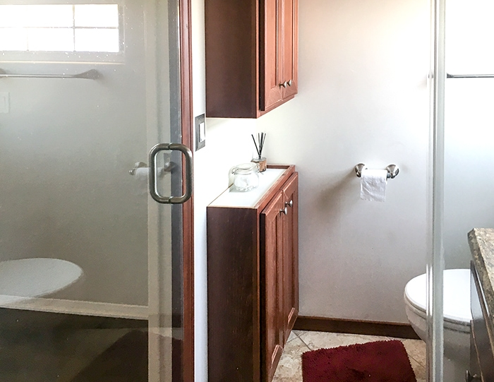 View of two cabinets installed in small bathroom