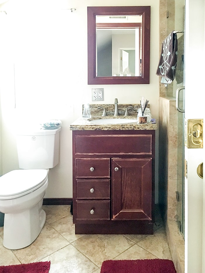 small bathroom remodel before view - brown cabinets.