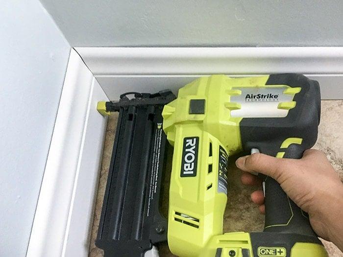 Installing baseboards using a nail gun