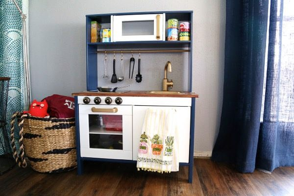 Ikea duktig play kitchen makeover with gold and navy paint