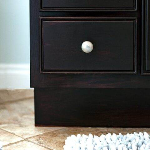 Learn how to use gel stain to easily update cabinets without any heavy sanding or stripping. The step-by-step tutorial and video showyou how to update outdated cabinets quickly with this affordable idea.