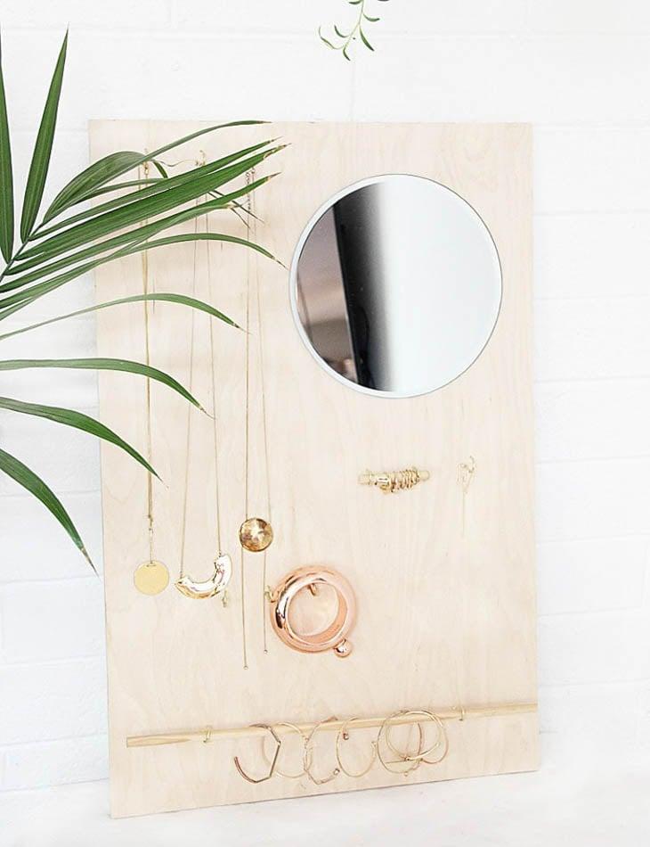 Wooden hanging jewelry organizer with round mirror
