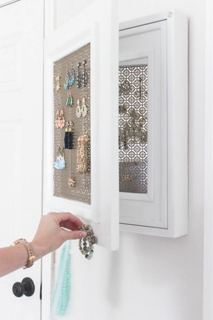shadow box painted white as a hanging jewelry organizer