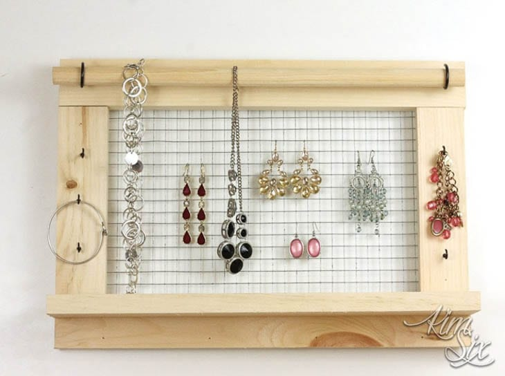 Wood DIY hanging jewelry organizer made from 1x2 and a dowel