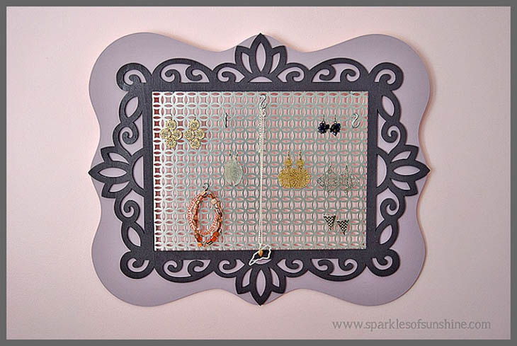 Purple painted frames with metal sheets for hanging jewelry
