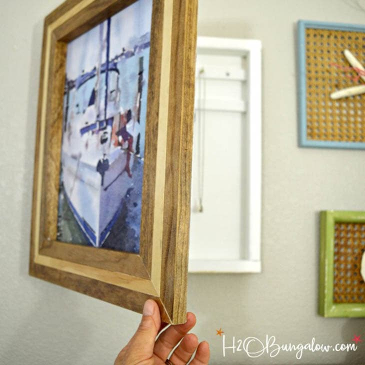 Shadow box with artwork as the door to hide jewelry storage