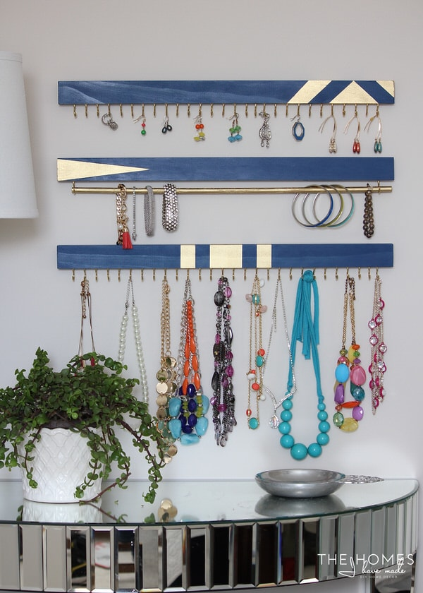 blue and gold 1x2s with cup hooks for DIY wall jewelry organization