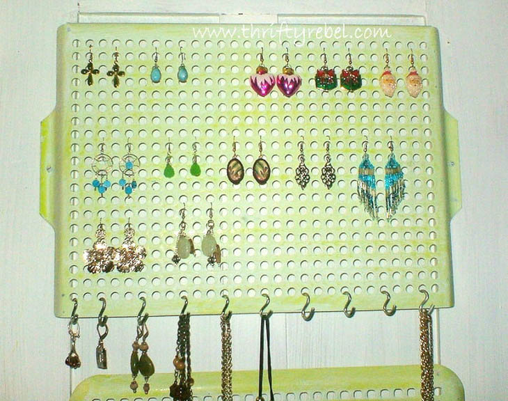 Green painted grill covers used for hanging jewelry organization