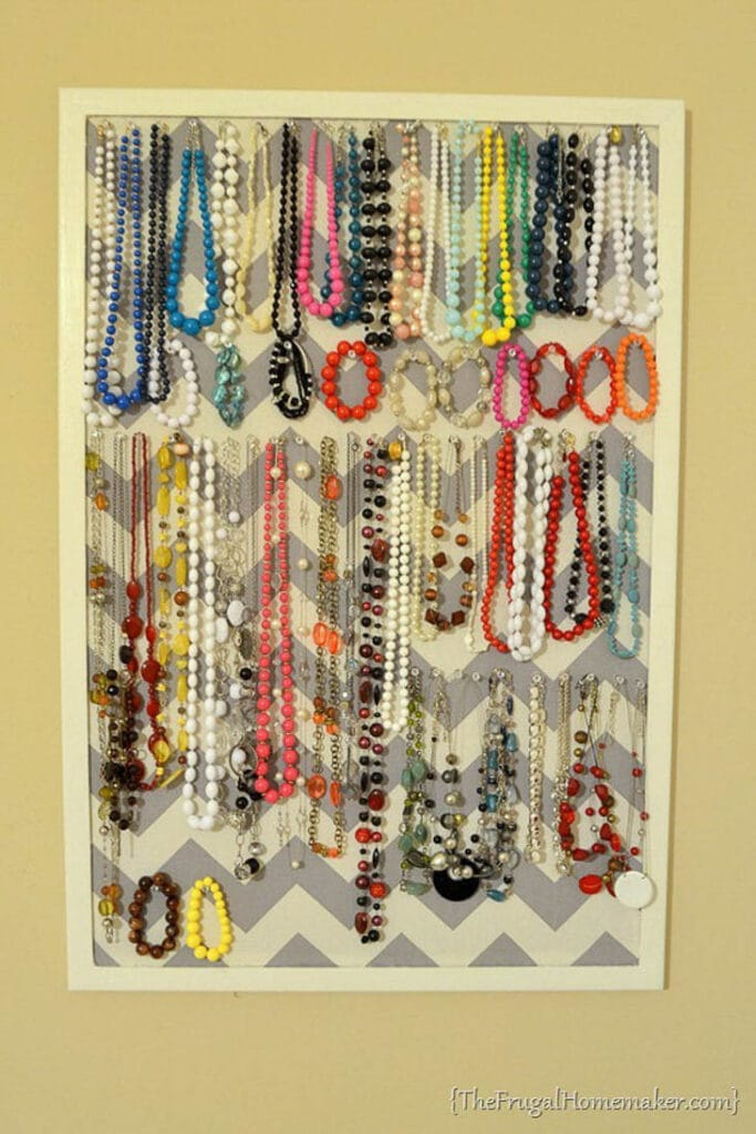 DIY hanging jewelry holder with gray chevron background