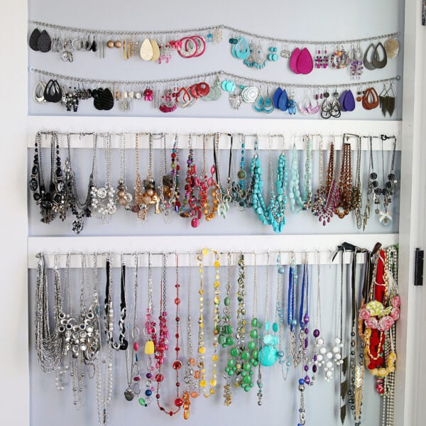 4 rows of jewelry hanging on the wall