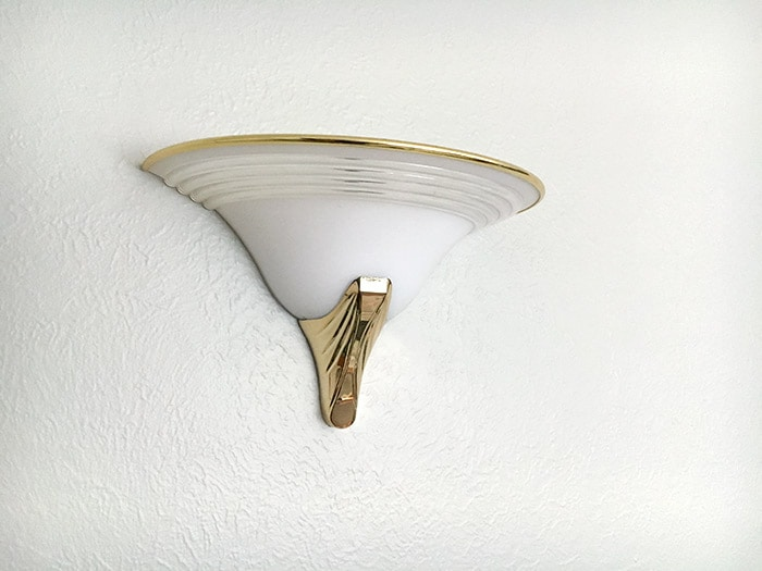 outdated light fixture to be replaced with DIY wall sconce