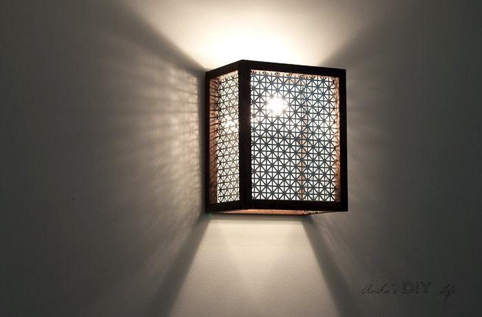 DIY wood light sconce with light turned on. How to make a light sconce