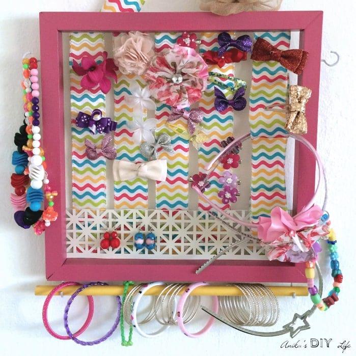 pink framed hanging jewelry organizer