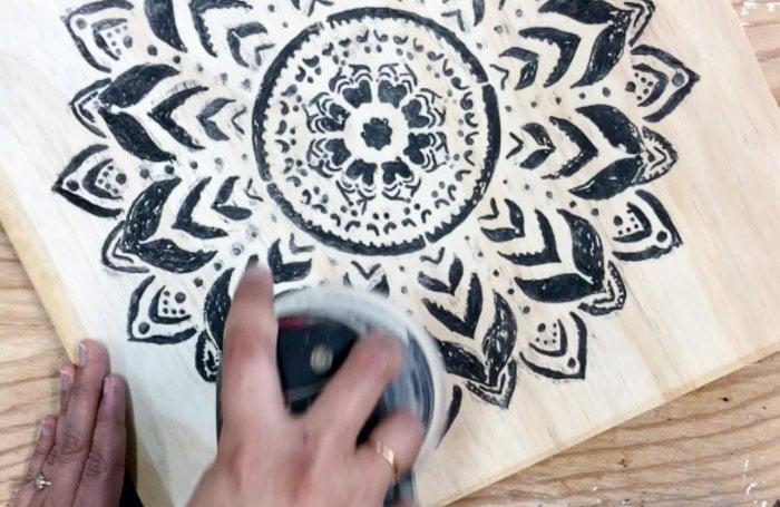 Dremel Wood carving - sanding the carved design to reveal engraved design.