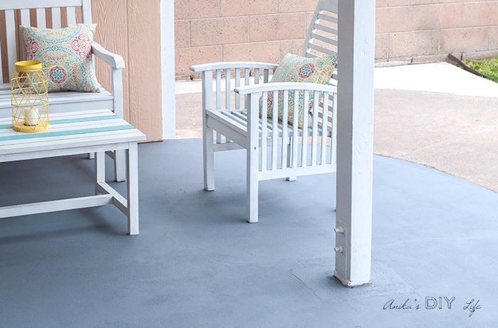 Outdoor space with stained patio and DIY furniture