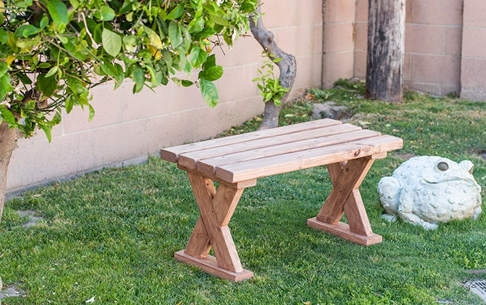 DIY 2x4 bench outdoors on the grass