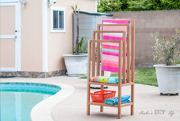 DIY freestanding towel rack in backyard next to pool