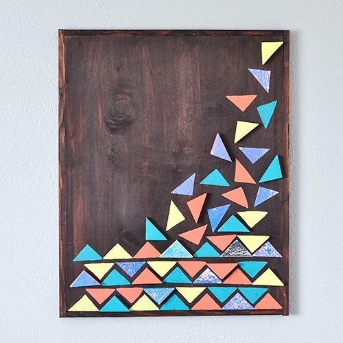 How to make an easy DIY wood wall art using few pieces of scrap wood. Full step by step tutorial and video to make the large-scale colorful geometric wall art.