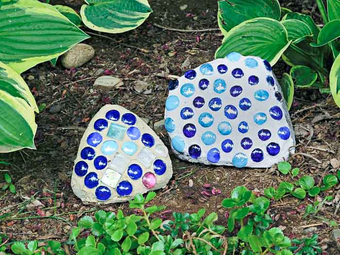Blue and navy mosaic rocks in the garden.