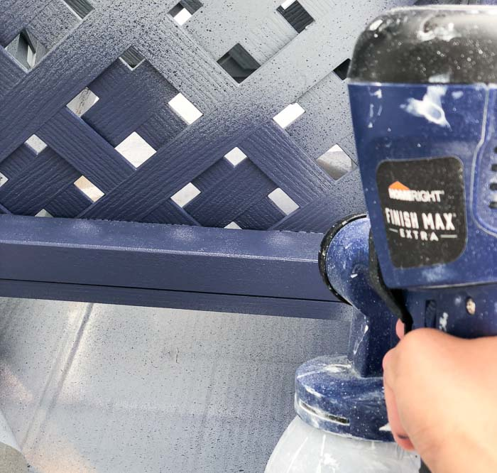 Painting the DIY planter box navy with the HomeRight Finish Max paint sprayer