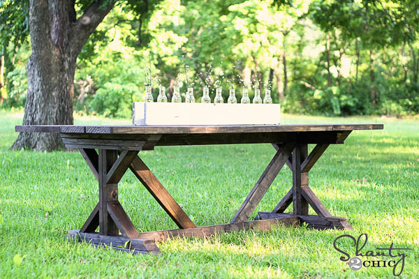X-base dining table in grass