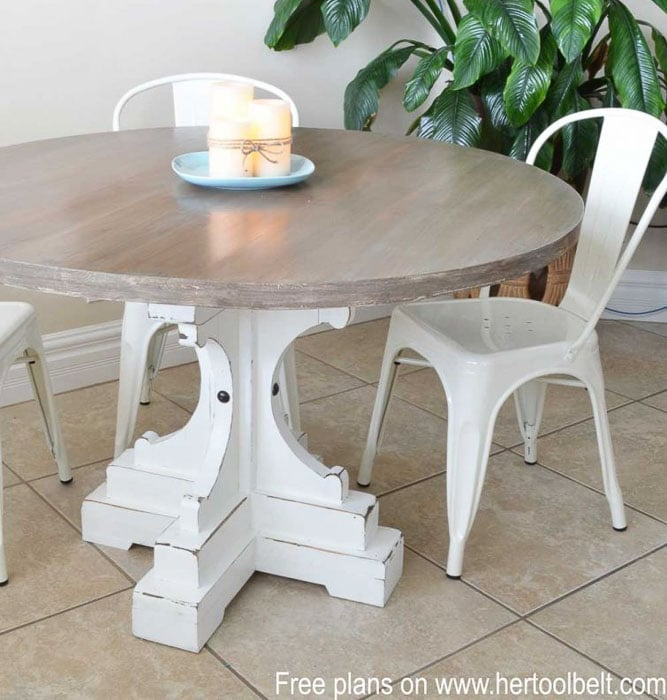 Round farmhouse table with pedestal feet and white chair
