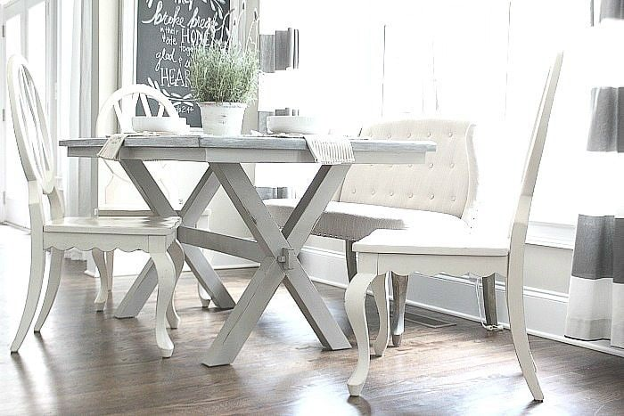 DIY Farmhouse table with X-base and white chairs