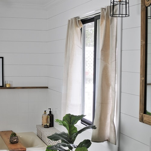 Make no-sew drop cloth curtains with this easy step by step tutorial. Transform your home on a budget with this easy and quick DIY home decor project.