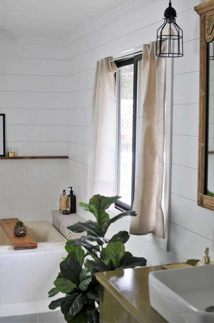Full view of the no-sew drop cloth curtain in the bathroom