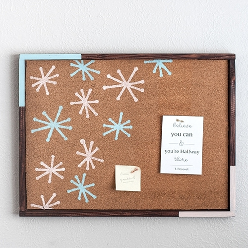 Make a gorgeous DIY cork bulletin board with a roll of cork and scrap wood with this full tutorial with pictures. This easy stenciled cork board adds fun, color, and function to any room!