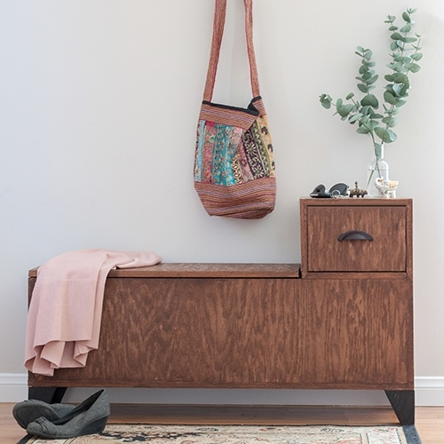 Build a DIY entryway bench with covered storage for shoes or jackets and a drawer to stash your keys or small items. Get the full printable plans.