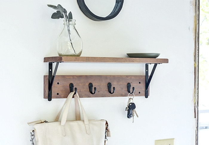 closeup of DIY Entryway shelf with hooks