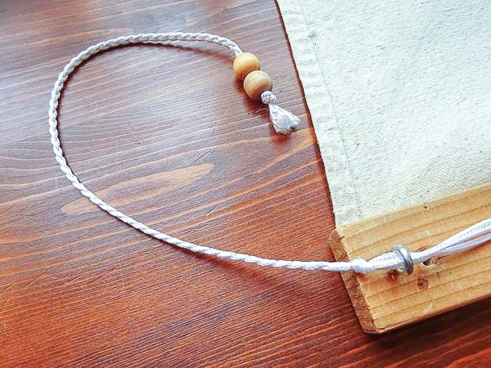 braided pull cord of DIY roman shade using drop cloth