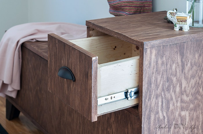 Open drawer in storage bench with drawer pull