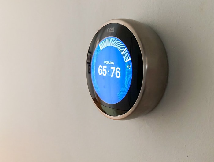 Smart thermostat on wall.