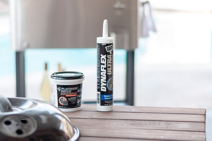 DAP caulking and patching material on grill table